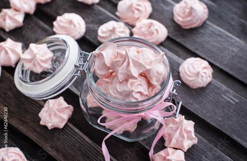 Pink meringues in a glass jar