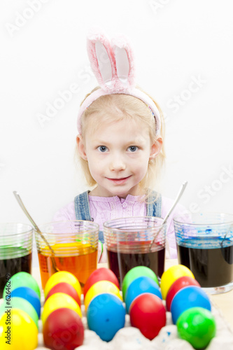 portrait of little girl during Easter eggs'' coloration