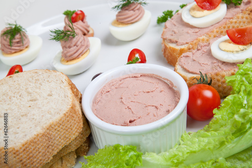 plate with slices of bread with home made pate,with vegetables