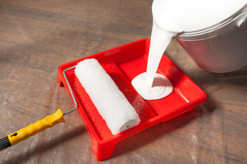 Pouring Paint In A Paint Tray