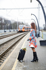 Woman waiting train and see other coming