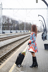 Woman waiting train and look other direction