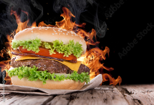 Delicious hamburger with fire flames