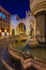 Brunnenbuberl Fountain and Karlstor Gate in the Evening, Munich,