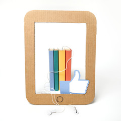 Paper illustration of an audiobook with a like sign
