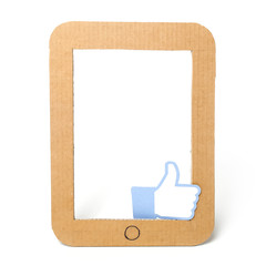 Empty cardboard tablet pc frame with a like sign