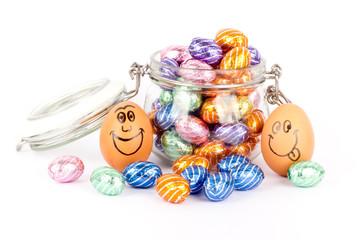 Happy eggs between chocolate easter eggs
