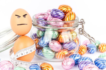 Angry egg between chocolate easter eggs