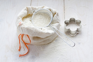 Sack with flour and cookie cutter