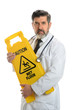 Doctor Holding Caution Sign