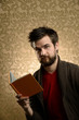 Young Man with Beard Holding Book