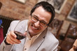 Happy man with glass of red wine