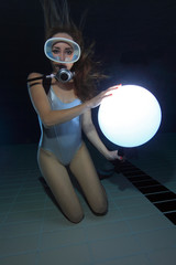 Scuba woman with sphere underwater