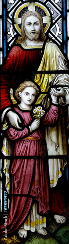 Jesus Christ with child: The Good Shepherd in stained glass
