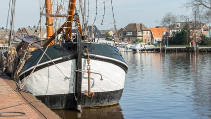 Historic flatboat in the olld harbor of Zwartsluis Holland