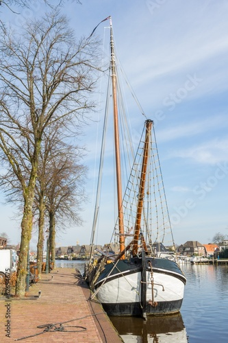 Historic flatboat in the olld harbor of Zwartsluis Holland