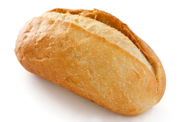 Single crusty mini baguette on white surface