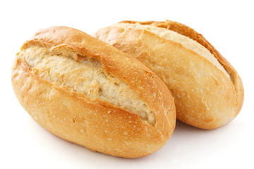 Two crusty mini baguettes on white surface