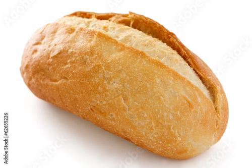 Fotobehang Brood Single crusty mini baguette on white surface