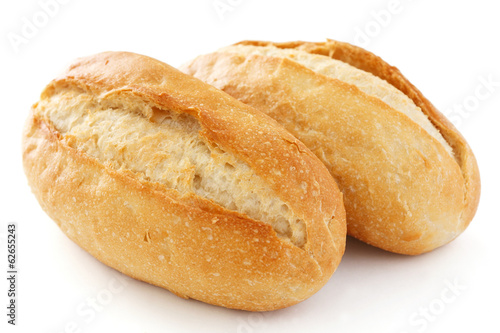 Staande foto Brood Two crusty mini baguettes on white surface