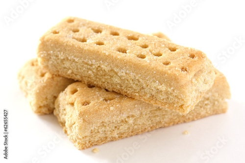 Classic shortbread finger biscuits on white surface
