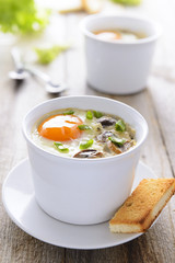 Baked egg with mushrooms and toast
