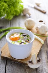 Baked egg with mushrooms and chive