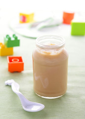 Pear puree in jar for baby nutrition