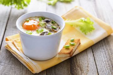 Baked egg with mashrooms and toast