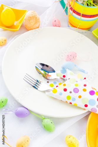 Easter table setting silverware wrapped napkin