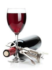 Red wine glass, bottle and corkscrew