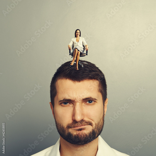 smiley woman sitting on the head of man