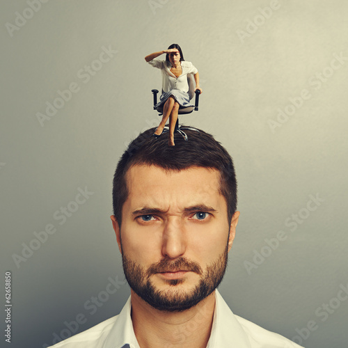 woman sitting on the man and looking