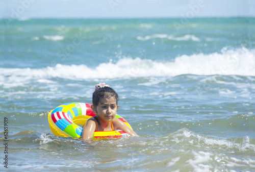 cute little girl swimming in the sea