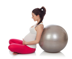 Beautiful pregnant woman doing pilates