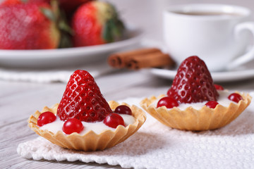 two tartlets with strawberries, cranberries and cream
