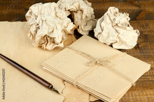 Crumpled paper balls with ink pen and envelopes