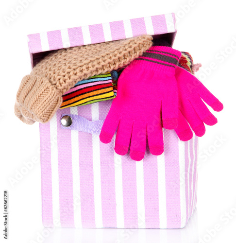 Textile box with different clothes, isolated on white