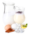 Eggnog with milk and eggs isolated on white