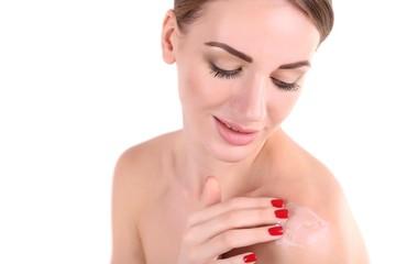 Beautiful girl moisturizing body cream, close-up, isolated