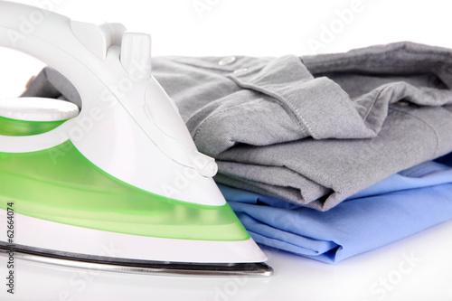 Iron with shirts close up