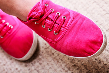 casual vibrant pink sneakers shoes boots on female feet