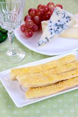 Cheese, grape and bread sticks