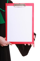 Woman lawyer in classic polish gown holds clipboard blank sign