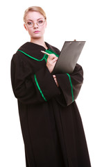 Woman lawyer in classic polish gown writing on clipboard