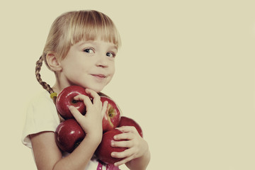 child holding apples