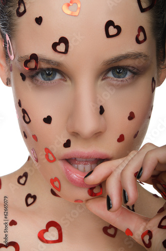 Young beautiful woman with heart on face