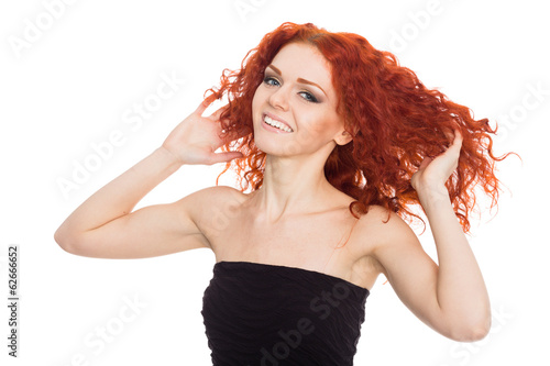 Joyful young woman with arms raised