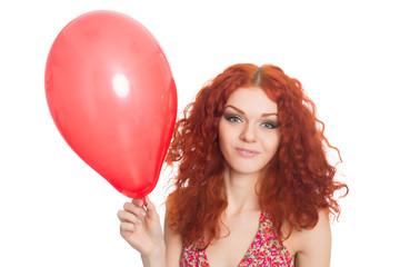 Joyful redhead girl holding balloon