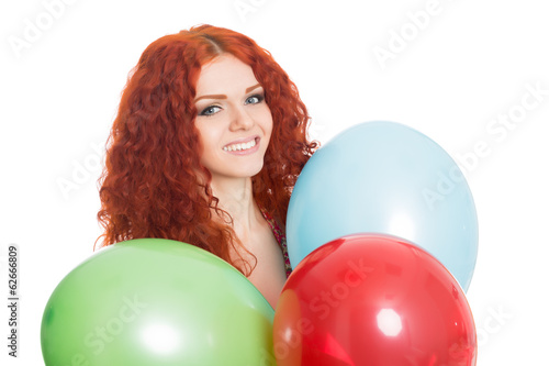 Joyful girl holding colorful balloons.